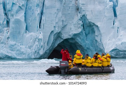 Noraustlandet, Svalbard, Norway, July 11th, 2013: people traveling in a zodiac in between glaciers of Svalbard