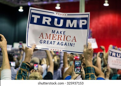 NORCROSS, GA, USA - OCTOBER 10TH, 2015: Supporter holding a campaign sign for a Presidential Candidate from Republican Party Donald Trump at a rally near Atlanta, GA in Norcross