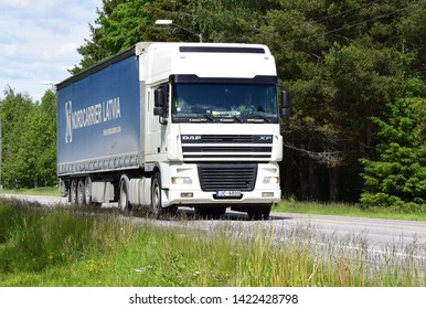 Nordcarrier Latvia sign on DAF truck vehicle on the road transporting goods for delivery - sunny and summer season - Kongsvinger, Norway (11th june 2019)