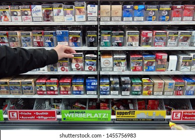 NORDHORN, GERMANY - DECEMBER 2 2016: packagings cigarettes near the checkout of a Kaufland Hypermarket . Pictures on cigarette packs, warning of smoking dangers.