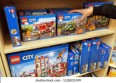 NORDHORN, GERMANY - DECEMBER 23, 2016: Lego City boxes on shelves in a Toys store. LEGO is a popular line of construction toys manufactured by The Lego Group.