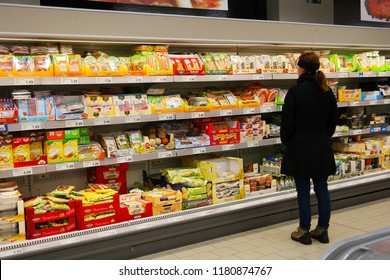 NORDHORN, GERMANY - DECEMBER 23, 2016: Shopper in the cooled fresh department of an ALDI Nord discount supermarket.