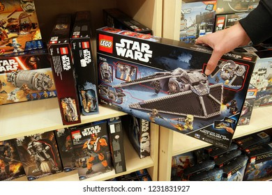 NORDHORN, GERMANY - DECEMBER 23, 2016: boxes Lego Star Wars theme on shelves in a Toys store. LEGO is a popular line of construction toys manufactured by The Lego Group.