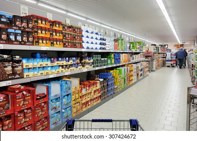 NORDHORN, GERMANY - DECEMBER 23: Shelves with a variety of coffee products in a Aldi supermarket, Aldi is a leading global discount supermarket chain with over 9,000 stores. Taken on December 23, 2014