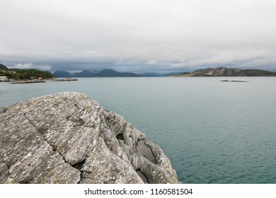 Nordic landscape with rocky coast line during an overcast day.
