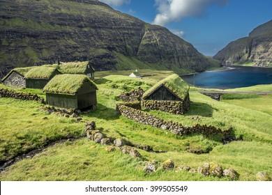 Nordic natural landscape, Saksun, Stremnoy island, Faroe Islands, Denmark. Iconic green roof houses.