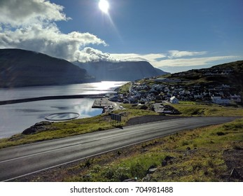 Nordic natural landscape with a small town on the background, Eiði, Faroe Islands, Denmark