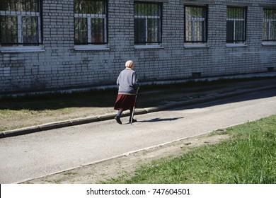 Nordic walking exercise adventure Hiking concept - closeup of woman grandma
