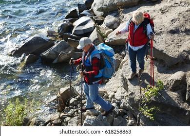 Nordic walking of senior couple at leisure