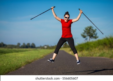 Nordic walking - young woman training