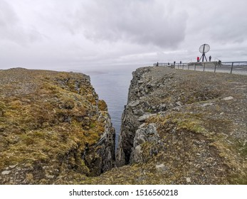 Nordkapp / Norway - July 2019: Nordkapp cliffhanger with the globus monument in summer cloudy day. Finnmark, Magerøya island.