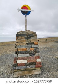 Nordkapp / Norway - July 2019: Nordkapp cliffhanger with Child Peace monument in summer cloudy day. Finnmark, Magerøya island.