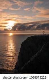 Nordkapp, Norway - June 08, 2010:   Every summer, tourists trek to 1000ft high cliff at Nordkapp (North Cape) Norway - promoted as the most northernmost point of Europe.