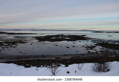 KJERRINGØY, NORDLAND COUNTY / NORWAY - FEBRUARY 09 2019: Winter view on the falling tide near the Kjerringøy, Norway