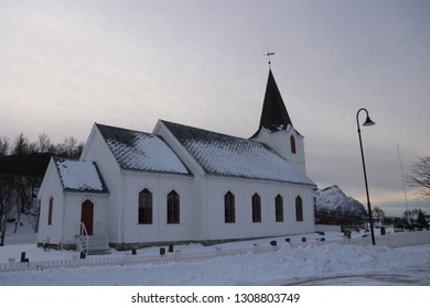 KJERRINGØY, NORDLAND COUNTY / NORWAY - FEBRUARY 09 2019: Kjerringøy Church is a parish church . The white, wooden church was built in a long church style in 1883