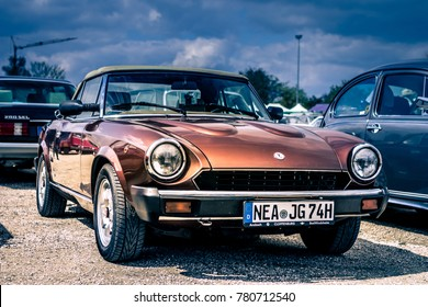 Nordlingen, Germany - April 29, 2017: Fiat Pininfarina Spider oldtimer car at the MotoTechnika oldtimer meeting on April 29, 2017 in Nordlingen, Germany. Front side view.