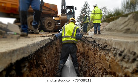 Nord-Pas de Calais/France-October 30 2013: Installation of a storm drain and evacuation pipe under a rural road.