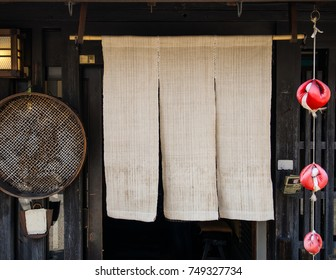 Noren - Japanese shop curtain and Sarubobo dolls