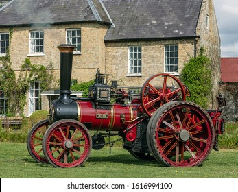 NORFOLK, UK - 04/28/2019: Steam Traction Engine  'Jessie' in front of farmhouse