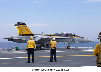 NORFOLK, VA - JUNE 27: An F18 launches from the deck of the USS Harry S. Truman on June 27, 2014. The aircraft carrier also known as CVN-75 and crew are stationed in Norfolk, VA.