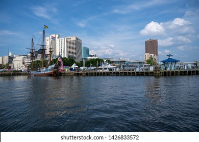 Norfolk, VA, USA -- June 6, 2019. A wide-angle photo of the Norfolk Marina  preparing for the annual Harborfest celebration.