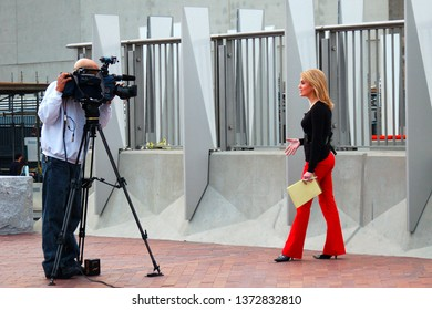 Norfolk, VA, USA March 13, 2007 A newswoman reports live on camera from an event in Norfolk, Virginia