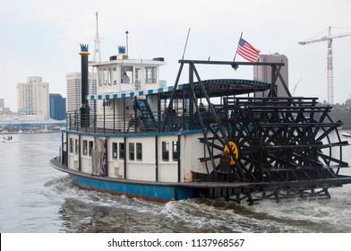 NORFOLK, VA, USA - MAY 4, 2012: Steamboat operated by Hampton Roads Transit (HRT) connects downtown Norfolk to Old Town Portsmouth across Elizabeth River in Norfolk, Virginia, USA.
