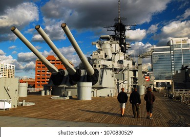 Norfolk, VA, USA October 27, 2008 Three adults tour the deck of the USS Wisconsin, docked in downtown Norfolk, Virginia