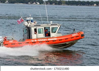 Norfolk, VA / USA: September 28, 2014: U. S. Coast Guard Safe Boat Defender Patrol Boat in the Norfolk Port