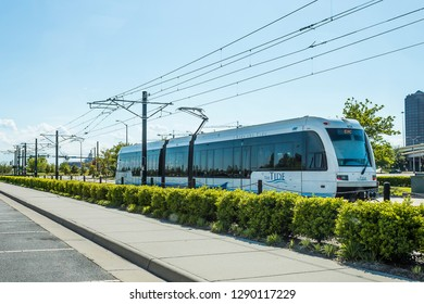 NORFOLK, VIRGINIA - MAY 2, 2015:  The Tide light rail system as it heads toward the Harbor Park Baseball Stadium Station.  The Tide is the first light rail system in Virginia.