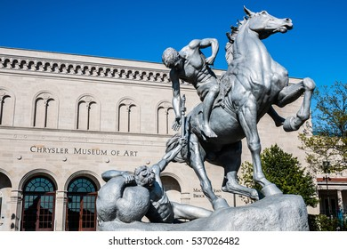 "NORFOLK, VIRGINIA - MAY 2, 2015:  ""The Torchbearers"" statue by Anna Hyatt Huntington, located in front of the Chrysler Museum of Art."