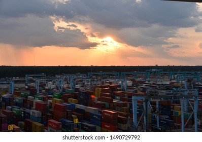 Norfolk, Virginia / USA - August 10 2019: panorama view on the container terminal in the port of Norfolk during a sunset.