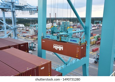 Norfolk, Virginia / USA - August 10 2019: Gantry cranes are discharging cargo from the container ship.