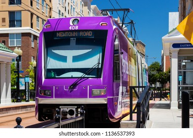 NORFOLK, VIRGINIA, USA – July 14, 2018: A Tide train moves through downtown Norfolk. This 7.4 mile light rail line is operated by Hampton Roads Transit.