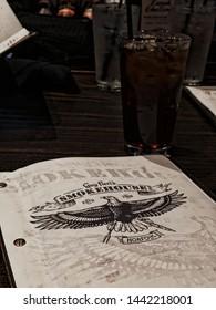Norfolk, Virginia / USA July 3, 2019:  The Guy Fieri Smokehouse menu. Located in the Waterside District in Norfolk, Virginia