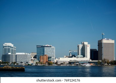 NORFOLK, VIRGINIA, USA - OCTOBER 21, 2017: The skyline of downtown Norfolk as seen across the Elizabeth River from Portsmouth.