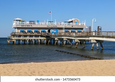 NORFOLK, VIRGINIA/USA - JULY 22, 2019:  Ocean View fishing pier, restaurant and tackle shop, located on Chesapeake Bay.