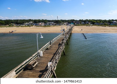 NORFOLK, VIRGINIA/USA - JULY 22, 2019: An aerial view of the Ocean View fishing pier as it extends toward Ocean View Beach and resort area.