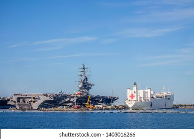 NORFOLK, VIRGINIA/USA - MAY 15, 2019: U.S. naval hospital ship Comfort next to nuclear-powered aircraft carrier USS Dwight D. Eisenhower at Naval Station Norfolk.