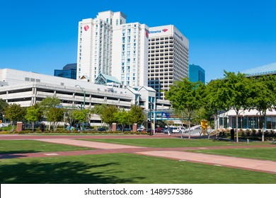 NORFOLK, VIRGINIA/USA - MAY 2, 2015: View of downtown skyline as seen in the park adjacent to the Waterside entertainment venue.