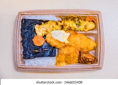 Nori bento or noriben. Japanese lunch box included rice, fried fish, seaweed and others.