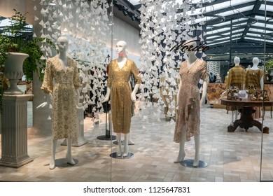 Noriko shop at Emquatier, Bangkok, Thailand, Jun 29, 2018 : Luxury and fashionable brand window display. Thai traditional pattern clothings showcase at flagship store.