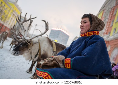 Norilsk, Krasnoyarsk region, Russia - November 17, 2018: A young man in traditional fur clothing of the indigenous peoples of Taimyr. Reindeer team. Argish ethnic festival in Norilsk city.