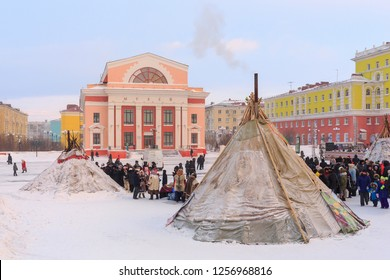 Norilsk, Krasnoyarsk region, Russia - November 17, 2018: Argish ethnic festival in Norilsk city. On the square there is a chum (tent). Behind them you can see the Museum building.
