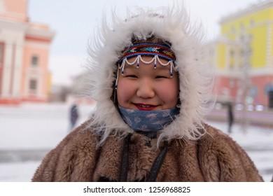 Norilsk, Krasnoyarsk region, Russia - November 17, 2018: The girl in traditional fur clothing of the indigenous people of Taimyr. Argish ethnic festival in Norilsk city.