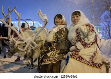 Norilsk, Krasnoyarsk region, Russia - November 17, 2018: Women in traditional fur clothing of the indigenous peoples of Taimyr. Reindeer team. Argish ethnic festival in Norilsk city.