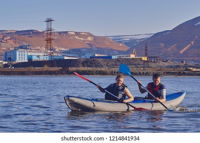 Norilsk, Russia - June 20, 2017: a guy and a girl floating on a kayak
