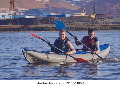 Norilsk, Russia - June 20, 2017: a guy and a girl floating on a kayak.