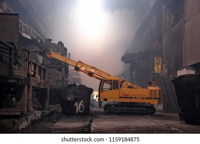 Norilsk, Taimyr /Russia - 23.08.2013:  The excavator operates in the melting shop of the Copper Plant of Norilsk Nickel (Nornickel) company