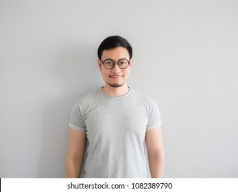 Normal face of ordinary Asian man with eyeglasses.